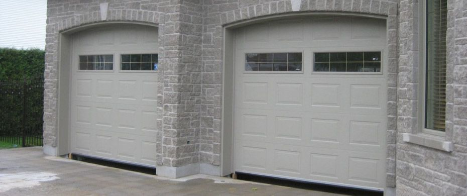 two garage doors white and windows